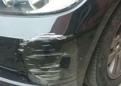 Image of a BMW car with a bumper scuff