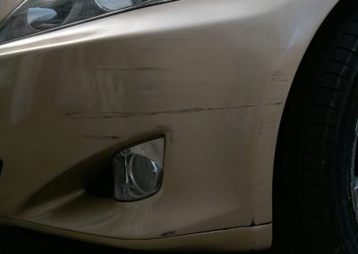 Photo of car with a bumper scuff