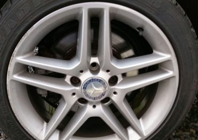 Image of an alloy wheel with scrapes