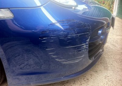 Image of badly scuffed bumper
